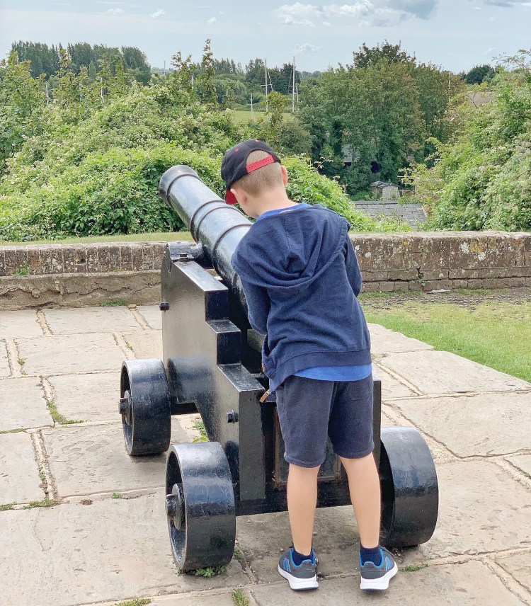 Stopping to admire the cannons whilst in Rye with kids