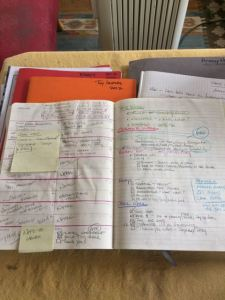 Weekly planner and pile of notebooks