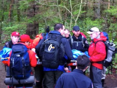 Search and Rescue crews carry injured boy off Rattlesnake Ledge.