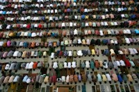 Students perform an afternoon prayer on the first day of the holy fasting month of Ramadaan, at Ar-Raudlatul Hasanah Islamic boarding school in Medan, North Sumatra, Indonesia, on July 10, 2013