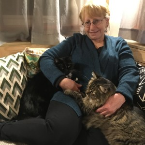 Kathi lounging with the kitties