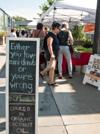 Minidonuts sign at market.