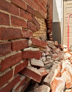 Bricks tumbled.