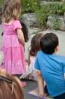 Kids watching dancers.