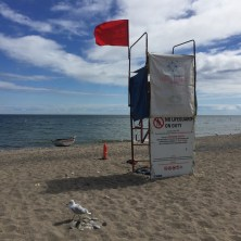 Red flag at lifeguard stand.