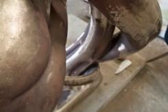 Detail, bronze figure.