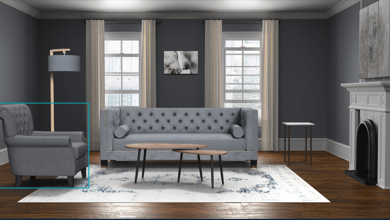 Image of a living room showing good contrast between the elements of walls, floor, rug, sofa, light and tables.