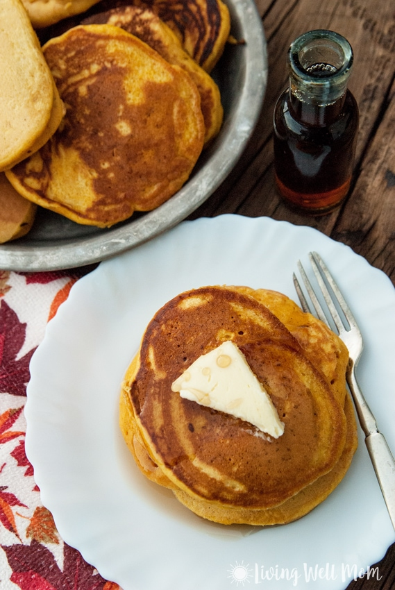 These are quite possibly the fluffiest, most deliciously spiced Pumpkin Spice Pancakes around. This simple recipe has been a family favorite for years!