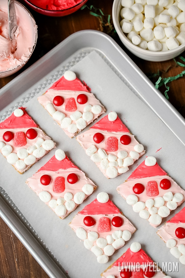 With no baking or cooking required, Santa Graham Cookies are a perfect easy Christmas cookie recipe for kids to make. They'll love decorating their cookies as much as they will eating them!