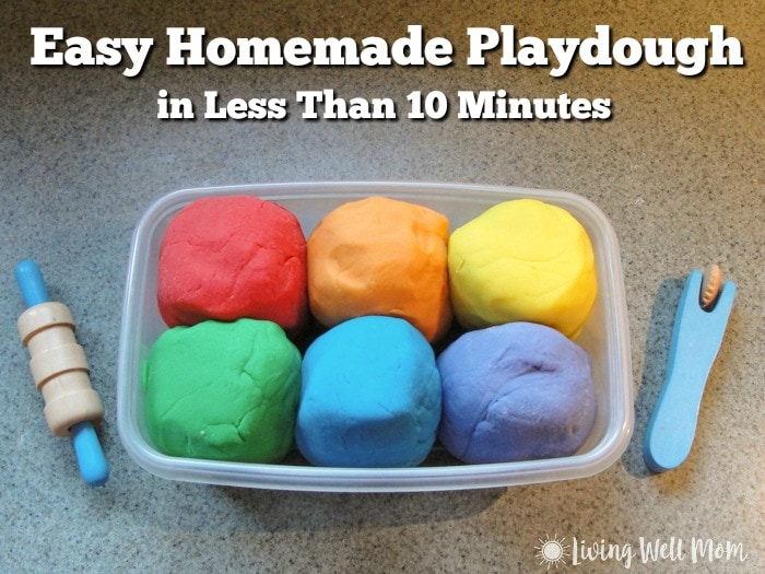 quick and easy homemade playdough recipe with rainbow colors in container with toys