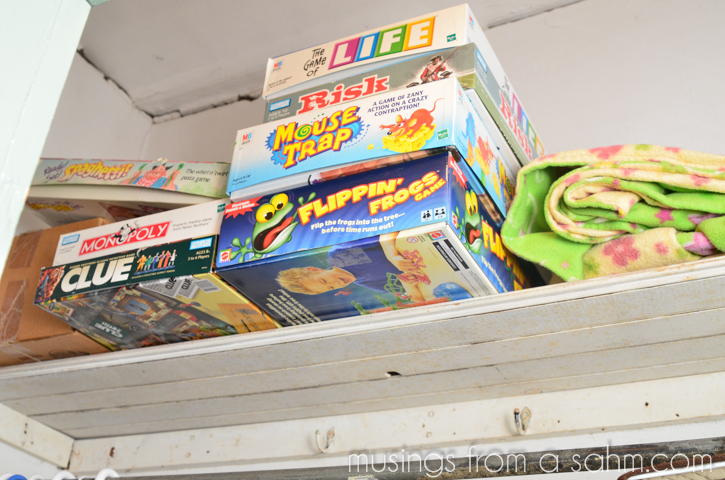 games on closet shelf