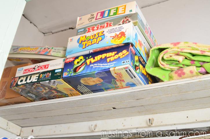 games on closet shelf
