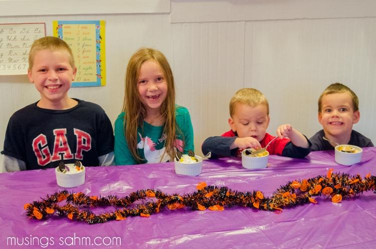 Kids eating Halloween pudding treat