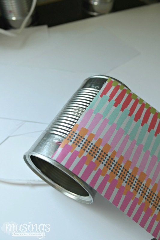 This Decorated Tin Can Organizer for Kids is perfect for storing scissors, pens, markers, glue sticks and so much more. Easy and inexpensive, this DIY project is cute enough to display on a desk or craft table. Adults will love it too!
