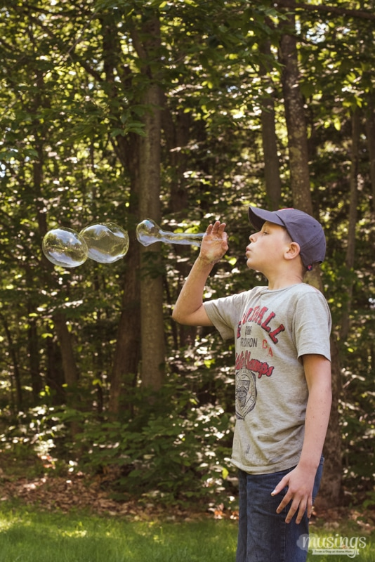 Kids will have hours of fun with this favorite activity - Homemade Bubbles! This simple recipe uses inexpensive basic ingredients and is super easy to make. Plus find instructions for how to make DIY bubble wands!