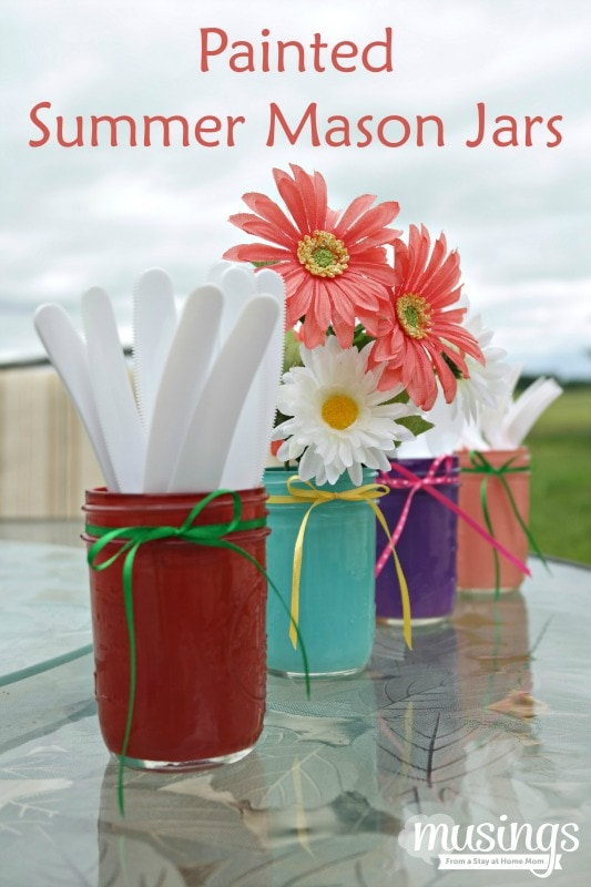 Add a touch of summer fun to your home with these simple to make Painted Summer Mason Jars - they're perfect for holding utensil at cookouts, as a pretty flower vase, or anything you want to display!