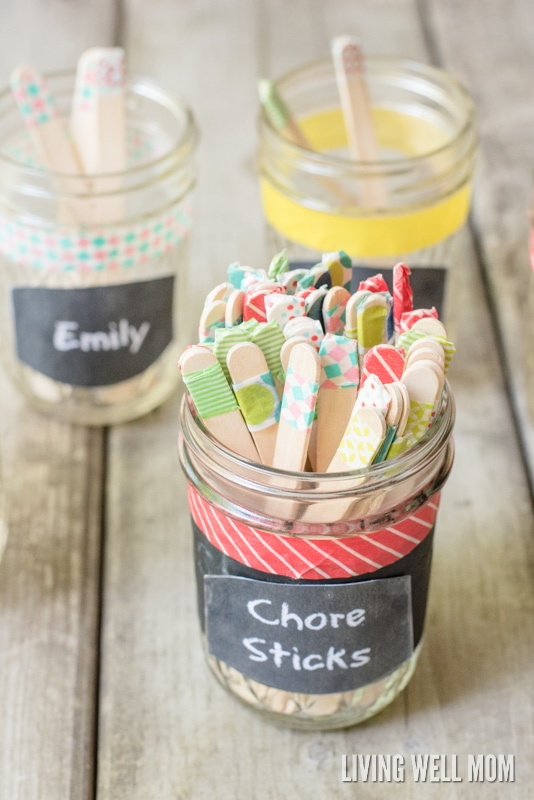 """Tired of fighting with your kids over chores? Check out this simple DIY chore system for kids that works so well, they may even beg you for more things to do! No fancy stuff or DIY-talent required, """"Chore Sticks"""" is easy peasy to set up. Plus get your free printable chart here too!"""