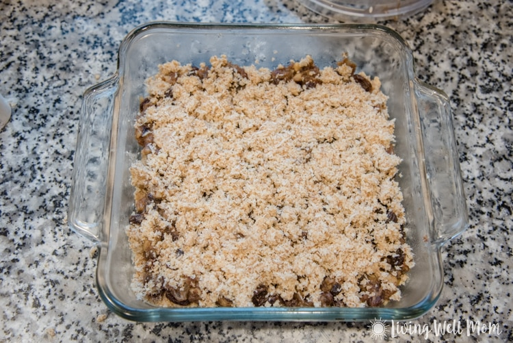 Old Fashioned Raisin Date Bars made Paleo style! This remade family favorite classic recipe is oh-so-good with a chewy date center and coconut flake almond flour crust and topping. You'll never guess it's grain free, dairy free, and refined sugar free!