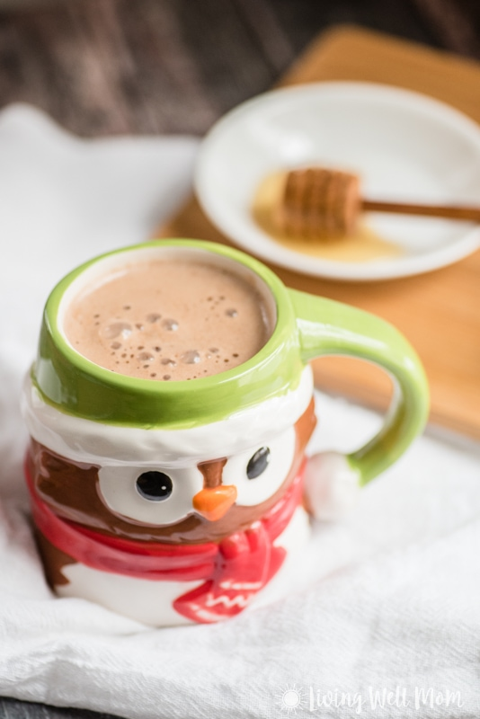 "Need an easy alternative to the processed hot chocolate from the store? Try this healthy hot cocoa recipe for kids! With just 4 simple ingredients, it's ""kid-approved"" delicious. Plus it's so easy to make, it's almost as fast as the store packets! Bonus: dairy-free, no-refined-sugar, and paleo!"