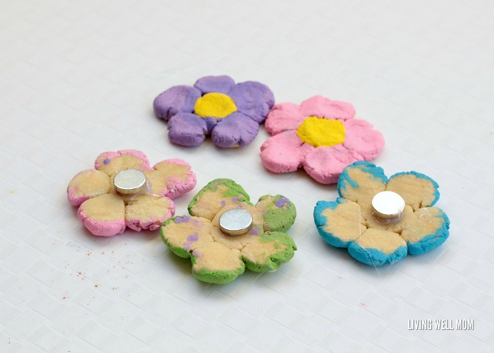 Delightful salt dough flower magnets are the perfect way to preserve your children's fingerprints in a fun, spring-themed project! Kids will love this fun activity!