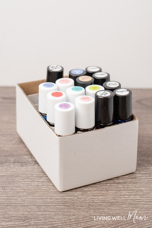 This simple solution for organizing essential oil roller bottles is genius! It's practically free, doesn't require any DIY talent, and works perfectly for keeping roller bottles stored upright with convenient, easy-to-find access.