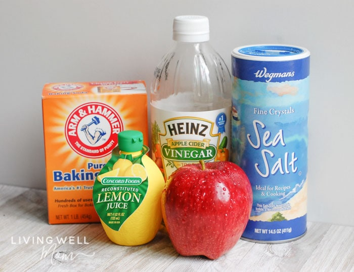 fruit and veggie wash soak ingredients - baking soda, vinegar, salt, lemon juice with apple