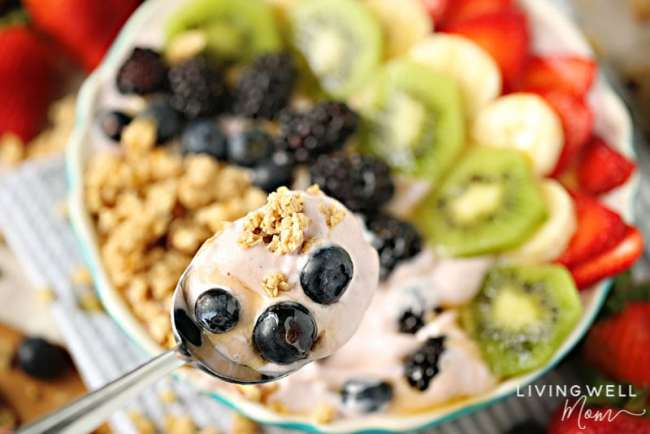 spoonful of delicious fruit granola yogurt bowl