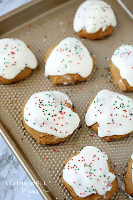 chewy frosted ginger cookies on a cookie sheet