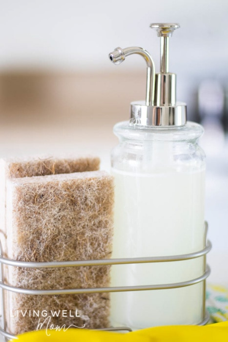 diy dish soap in a dispenser with a sponge