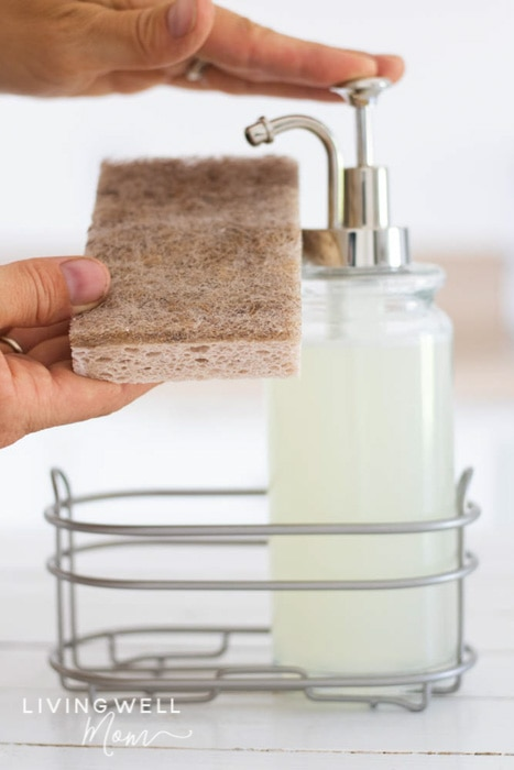 squirting homemade liquid dish soap onto a sponge