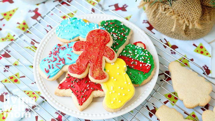 plate of frosted gluten-free sugar cookies with sprinkles