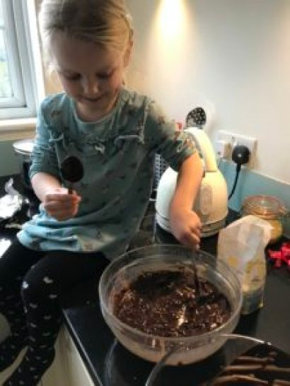 Young girl stirring cake mixture