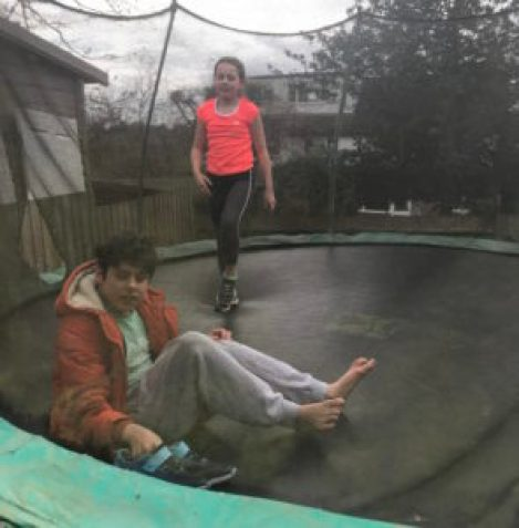 Jude and his sister Elsa on a trampoline