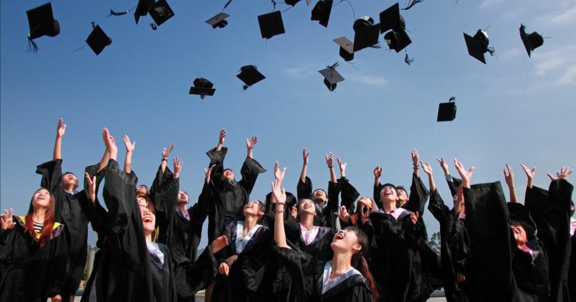 graduates-throwing-caps-into-air