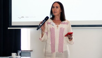 woman-speaking-into-microphone