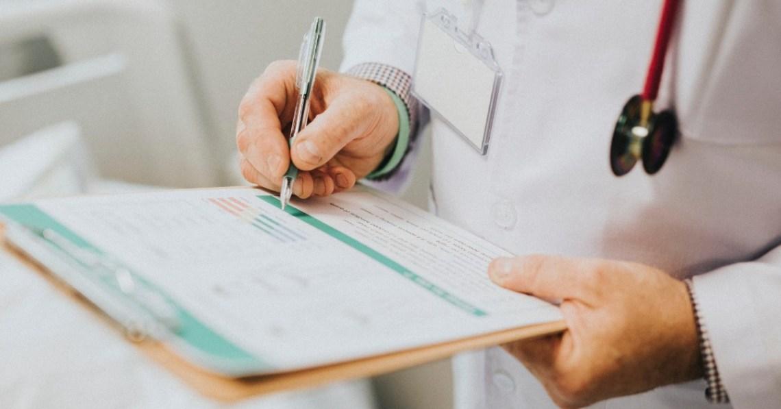doctor-writing-clipboard