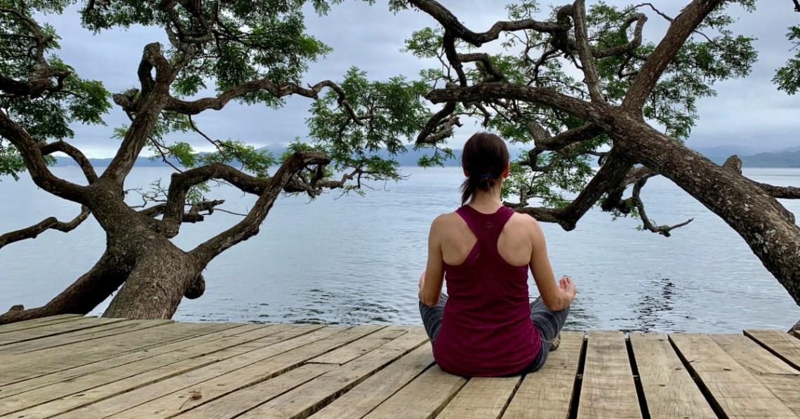 woman-meditating-among-trees