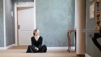 woman-sitting-alone-on-floor