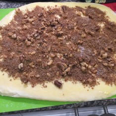 Dough covered with nuts, sugar and cinnamon