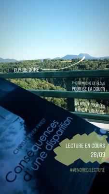 Puy de Dôme et lecture en cours, photo en cours de route pour les Aventuriales 2018