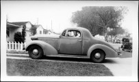 My dad in 1942, just before heading off to war in Europe, in his funny-looking car.