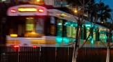 A Metro train rolling past USC around dusk.