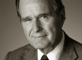 An indoor hotel portrait of George Bush.