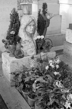 The first time I visited Morrison's grave at Pere Lachaise Cemetery just outside of Paris, before some hooligans absconded with the bust. No, it wasn't me.