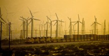 A freight train makes its way late in the day in front of a wind farm near Palm Springs, California.