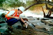 An AECOM engineer checking the chemical levels of the LA River.