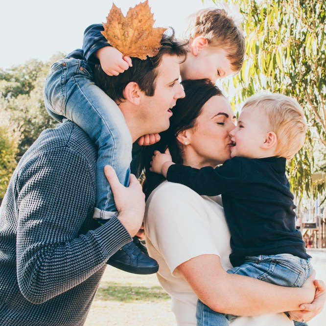 Melbourne Lifestyle Photography happy family hugging, kissing, interacting and connecting during Autumn season