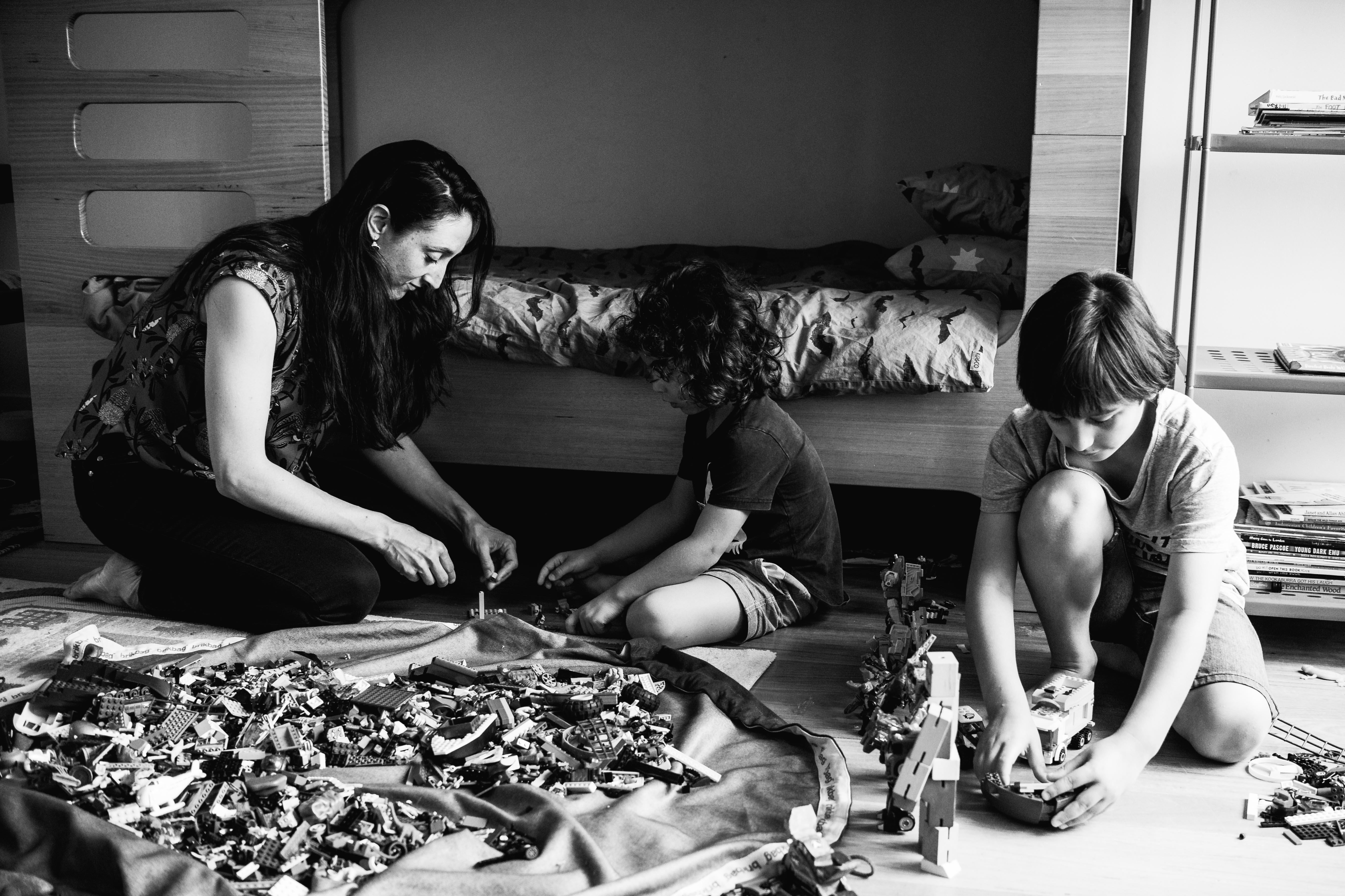 photograph of mother and her boys creating and building with Lego in their bedroom in Carlton North, Melbourne, Australia
