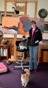 Lyn with her cats and amazing easel.