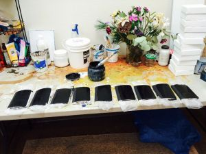 Painting each notebook with several layers of black gesso.